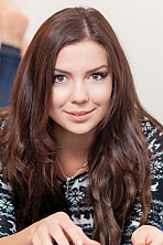 Ukrainian girl Anna,25 years old with brown eyes and light brown hair.