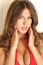 Ukrainian girl Svetlana,34 years old with blue eyes and light brown hair.