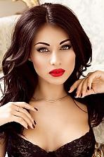 Ukrainian girl Karina,23 years old with green eyes and black hair.