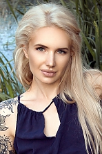 Ukrainian girl Svetlana,32 years old with brown eyes and blonde hair.