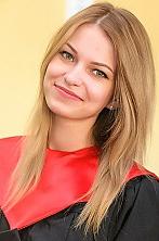 Ukrainian girl Juliya,23 years old with green eyes and auburn hair.