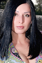 Ukrainian girl Elena,28 years old with green eyes and black hair.