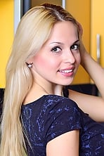 Ukrainian girl Kateryna,26 years old with brown eyes and blonde hair.
