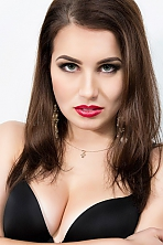 Ukrainian girl Anna,23 years old with green eyes and dark brown hair.