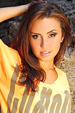 Ukrainian girl Julia,21 years old with brown eyes and light brown hair.