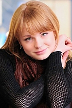Ukrainian girl Anna,23 years old with green eyes and red hair.