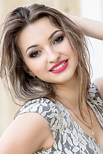 Ukrainian girl Anna,21 years old with brown eyes and light brown hair.