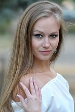 Ukrainian girl Anna,27 years old with blue eyes and light brown hair.