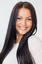 Ukrainian girl Anastasia,26 years old with brown eyes and black hair.