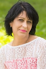 Ukrainian girl Liliya,45 years old with grey eyes and black hair.