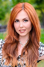 Ukrainian girl Anna,22 years old with green eyes and red hair.