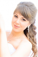 Ukrainian girl Anna,20 years old with brown eyes and light brown hair.