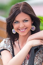 Ukrainian girl Irina,32 years old with blue eyes and dark brown hair.