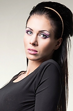 Ukrainian girl Irina,23 years old with blue eyes and dark brown hair.