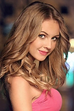Ukrainian girl Oksana,23 years old with green eyes and light brown hair.