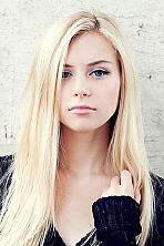 Ukrainian girl Kate,23 years old with blue eyes and blonde hair.