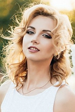 Ukrainian girl Victoria,19 years old with grey eyes and red hair.