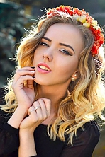 Ukrainian girl Ekaterina,19 years old with blue eyes and blonde hair.