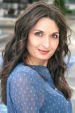 Ukrainian girl Anna,27 years old with brown eyes and black hair.