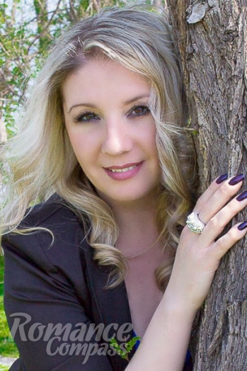 Ukrainian girl Snezhana,40 years old with brown eyes and blonde hair.