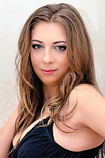 Ukrainian girl Ekaterina,32 years old with blue eyes and dark brown hair.