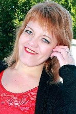 Ukrainian girl Svetlana,38 years old with green eyes and light brown hair.