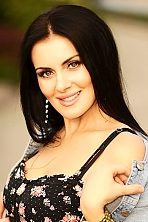 Ukrainian girl Anna,39 years old with blue eyes and light brown hair.