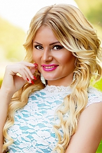 Ukrainian girl Anna,28 years old with brown eyes and blonde hair.