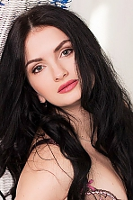 Ukrainian girl Elena ,29 years old with blue eyes and dark brown hair.