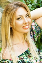 Ukrainian girl Elena,32 years old with brown eyes and light brown hair.