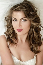 Ukrainian girl Marina ,25 years old with hazel eyes and light brown hair.