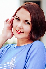 Ukrainian girl Elena,35 years old with grey eyes and auburn hair.