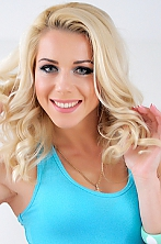 Ukrainian girl Alena,28 years old with green eyes and blonde hair.