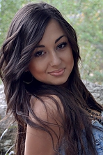 Ukrainian girl Kristina,23 years old with brown eyes and black hair.