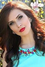 Ukrainian girl Daria,20 years old with green eyes and dark brown hair.