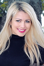 Ukrainian girl Irina,30 years old with grey eyes and blonde hair.