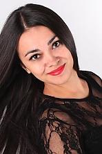Ukrainian girl Alexandra,24 years old with brown eyes and black hair.