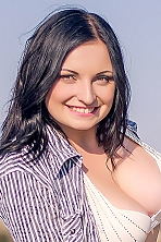 Ukrainian girl Nadezhda,23 years old with green eyes and black hair.