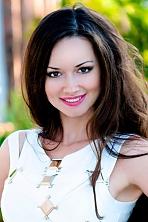 Ukrainian girl Inna,36 years old with green eyes and dark brown hair.
