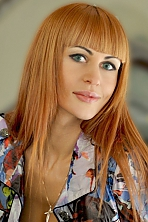 Ukrainian girl Anna,37 years old with grey eyes and red hair.