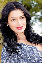Ukrainian girl Viktoria,32 years old with grey eyes and black hair.