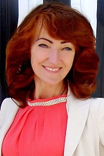Ukrainian girl Lidiya,45 years old with blue eyes and red hair.