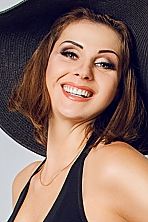Ukrainian girl Victoria,31 years old with blue eyes and dark brown hair.