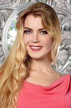 Ukrainian girl Svetlana,37 years old with brown eyes and blonde hair.