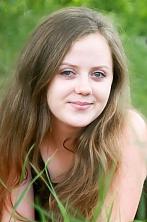 Ukrainian girl Inna,19 years old with green eyes and dark brown hair.