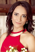 Ukrainian girl Lesya,31 years old with green eyes and light brown hair.
