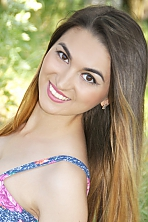 Ukrainian girl Elena,24 years old with grey eyes and black hair.