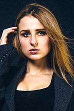 Ukrainian girl Violetta,18 years old with blue eyes and light brown hair.