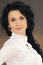 Ukrainian girl Viktoria,33 years old with brown eyes and black hair.