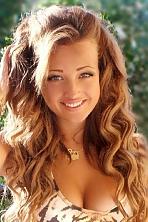 Ukrainian girl Vladislav,21 years old with green eyes and light brown hair.